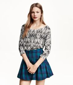 Plaid is big for Fall!  If you're bold, try it paired with another pattern, as in this match-up from H&M.