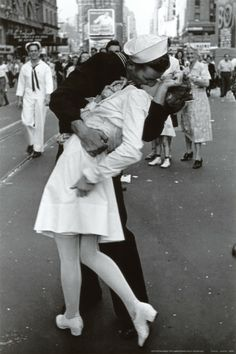 Kissing on VJ Day. My mother saw this picture again after she got Alzheimer's and, although she wasn't sure it she'd been there that day, she  was sure she recognized herself in the background.Soon after that, one of us found & bought a pocketbook with this picture on it for her and it meant so much to her.