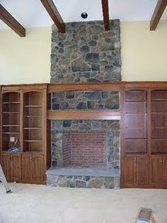 I don't like the yellow walls, but I do like the stone for the fireplace and the built-in shelving and exposed beams.