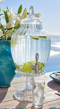 Crafted from molded and mouth-blown glass, this beautifully scalloped beverage dispenser brings charm and style to any table. Lemon Lime Water, Glass Beverage Dispenser, Spa Water, Swarovski, Infused Water, Summer Breeze, Beverages, Drinks, Natural