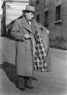 Trench Coat - credited to Thomas Burberry during WWI, the trench coat is a belted twill cotton gabardine of very close weave with a chemical finish that made the coat water repellent. They later became fashionable after the war.