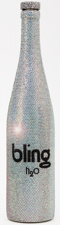 """The Ten Thousand"". This Bling H2O bottle  has over 10,000 hand applied Swarovski Crystals & cost $2,600.00USD For bottled water."