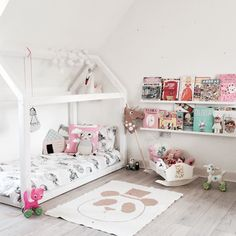 bed frame in a child room from https://instagram.com/chloeuberkid/