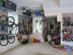 garage organization for a family of 10, garages, organizing, shelving ideas, storage ideas, An under stairs nook provides great garden tool storage