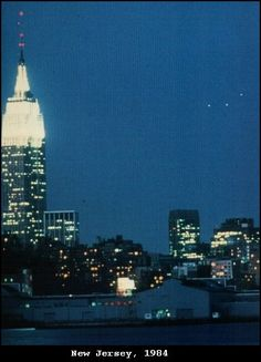 1984 - Hoboken, New Jersey, May 9 1984. Taken by Philipe Orego. Image shows either a triangular-shaped object or three or more objects flying as a unit.    Taken over the Manhattan skyline. The photograph has been examined by researchers who found no sign of a hoax.