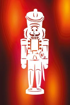 Basteln für Weihnachten: Dieser wundervolle Scherenschnitt mit Nussknackermotiv verschönert an Weihnachten Ihr Fenster. Wie Sie es basteln und die Vorlage zum kostenlosen Download finden Sie auf familie.de. © Christopherus Verlag