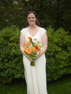Orange wedding:  Natural, textured bouquet of calla lilies, roses, stephanotis, Ladies Mantle, birch, dahlias, hypericum berries, and stock. WhimsicalWelcomes.com
