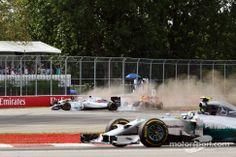 Nico Rosberg, Mercedes AMG F1 W05 takes the corner as Felipe Massa, Williams FW36 and Sergio Perez, Sahara Force India F1 VJM07 crash, narrowly avoiding Sebastian Vettel, Red Bull Racing RB10 on the last lap of the race