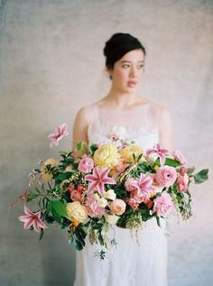 Pastel Pink and Yellow Centerpiece | Rebecca Hollis Photography | http://heyweddinglady.com/lush-fine-art-wedding-florals-spring/