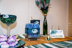 Peacock Candy buffet for party- use colors of the peacock & add a ribbon to give the jars some flair
