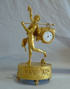 Miniature French Empire antique ormolu mantel clock of Bacchante.