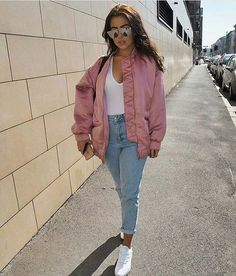 Pink satin bomber jacket, and high waist jeans.