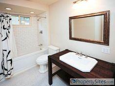 White countertop, white sink, wood vanity, white bathtub, white accessories?