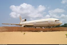 L-1011 - Not sure how they towed it through the sand on Cotonou Beach, Africa. Ex Rum Air.