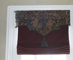 Roman shade with shaped valance.