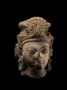 Carlton Rochell Asian Art  Head of Vishnu  India  6th/7th century  Terracotta  Height: 7 5/8 in. (19.5 cm.)