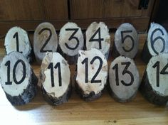 Our table numbers made out of little tree stumps for the Enchanted Forest!