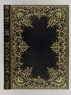 1744. Dark Blue Moroccan Binding with gilded lace-like decoration (dentelle) favored in the 18th C. Derome le Jeune using small gilding irons created volutes, scrolls, shells, floral and nearly abstract bird motifs (à l'oiseau).