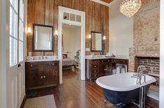 Love how this bathroom incorporates natural and weathered wood but still has white trim and plaster walls by MLM INCORPORATED