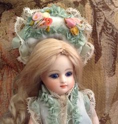 Tiny center part hand wefted wig for Mignonette.