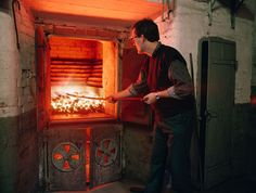 Raking the kiln fire at Balvenie distillery.
