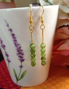 """Earrings ~ Glass Green Bead Drop Earrings ~ Clear and Semi Opaque ~ Gold Plated Ear Hooks ~ 2"""" drop ~ Handmade Fashion by Nerdacious on Etsy"""