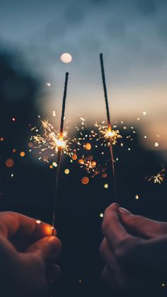 Sparklers like fires in the night. Burning apart, yet exactly the same. Like Twin Flames.