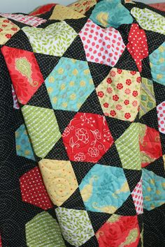 A Little Bit Biased: Summer House Hexagon Quilt - Gorgeous, love the colours and black polka dot triangles, very effective