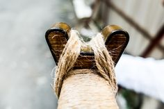 Hand carved wood bridge for bow string to rest upon, by Fischer Workshops fischerworkshops.com
