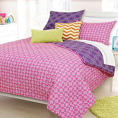 Liven up your princess' bedroom with the vibrant Ashlee Reversible Comforter Set. Adorned with a pink face and purple reverse, the bright and bold bedding instantly adds a fun pop of color to any room's décor.