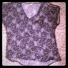 Cold shoulder cheetah print top size medium Open shoulders and slightly longer in back not a true hi low top however. Size medium EUC Eyeshadow Tops Blouses