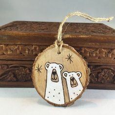 "(79) Personalized ""Our First Christmas"" Ornament: Rustic wood burned love birds on tree slice"