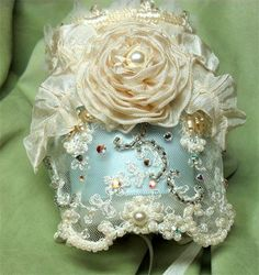 Marie Antoinette Lace Cuff: This English lace cuff is hand beaded with crystals, pearls and beads and finished off with a large ribbon rose, a great traditional vintage look