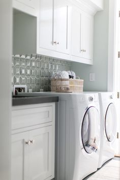 beautiful laundry room - love that three dimensional tile design and white cabinetry