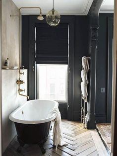 | BATHROOM | Jenna Lyons Brooklyn brownstone bathroom. Pared down yet still complex and intriguing. Love the concrete shelf recess detail.