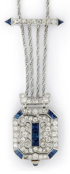 AN ART DECO PLATINUM, DIAMOND AND SAPPHIRE PENDANT WATCH, CIRCA 1930. The rectangular time piece with diamond and calibre sapphire pierced geometric design front panel, the reverse enclosing the watch with jewelled-lever movement, the rectangular silvered dial with Arabic numerals, to foliate engraved surround and edges and cabochon sapphire crown, suspended from two diamond bar panels and later Prince of Wales-link neckchain, 29.5cm, with applied plaque no. #ArtDeco #PendantWatch
