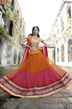 Women's Pretty Circular Lehenga Style in Orange Color. Message/call/WhatsApp at +91-9246261661 or Visit www.zinnga.com