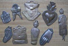 Milagros of women / body parts.