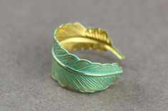 Feather Ring : Bohemian Gold Feather Wrap Ring, Feather Charm, Adjustable, Leaf, Simple, Casual, Yoga, Patina Teal Finish Coating. $10.50, via Etsy.