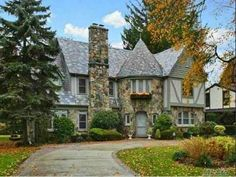 Tudor Style Home Entrance | Garden City, N.Y. Designed by famous architect Olive Tjadan, this ...