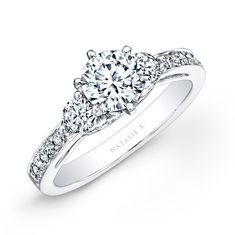 Three brilliant round diamonds sit front and center in this stunning diamond engagement ring that also features more round diamonds on top of the shank and the side profile for maximum sparkle and shine.