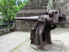 A Japanese cannon embedded in the Spanish city wall of Manila, the Philippines, has been left as a reminder of the wartime occupation. Manila, Philippines, Spanish, Japanese, City, Wall, Cannon, Japanese Language, Walls