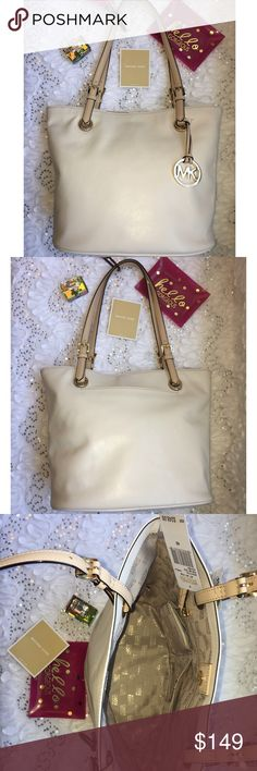 """Micheal Kors Jet set leather tote Guaranteed 100% Authentic.  NWT Michael Kors Medium Jet Set Leather Tote.  Material: Leather.  Color: Vanilla.  Gold Tone Hardware.  Magnetic Snap Closure.  1 Exterior Front Pocket.  1 Zip Pocket.  4 Multifunction Pockets.  Adjustable Dual Leather Buckle Straps.  Dimensions: Approx. 14.5"""" (L) X 10"""" (H) X 6.5"""" (H). Michael Kors Bags Shoulder Bags"""