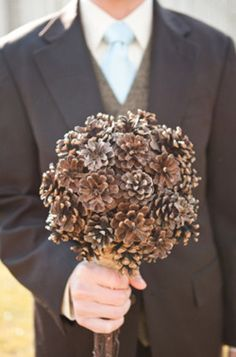 Neat winter bouquet idea! Pinecones! spray paint some white.. add some crystal glitter... so pretty