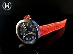 Blue green dial with blue case ring, orange strap. Pre-order now at marchandwatches.com
