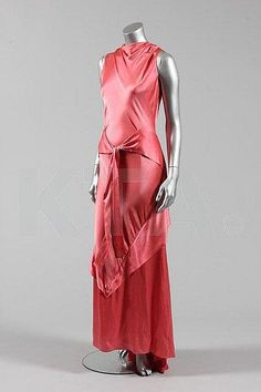 A deep rose-pink satin bias cut couture evening gown, possibly Charlotte Revyl, circa the draped neck cut high at the front with revers to the plunging back, cascading skirt flounces form a point at the front hem and with ties at the waist Pink Evening Gowns, Vintage Evening Gowns, Vintage Gowns, Vintage Mode, Vintage Clothing, Women's Clothing, 1930s Fashion, European Fashion, Vintage Fashion