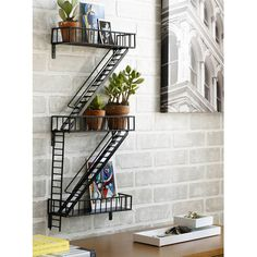 Hand-welded epoxy-coated steel makes this unique fire escape shelf as sturdy as it is inspiring. Description from interior-design-concept.blogspot.com. I searched for this on bing.com/images