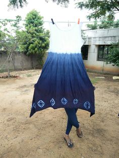 Garment is dyed with indigo tie dye and clamping process
