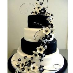 Gorgeous wedding cake, I'm thinking gray and yellow layers with white and yellow flowers