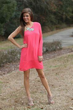 """This dress will not disappoint! The pink color of this silky material is gorgeous, and we love the one shoulder look this season. Plus, did you see the subtle chevron pattern on the sleeve and around the hemline? To die for!   Fits true to size. Miranda is wearing a small.  From the shoulder to the hem:  Small-34""""  Medium-34.5""""  Large-35"""""""